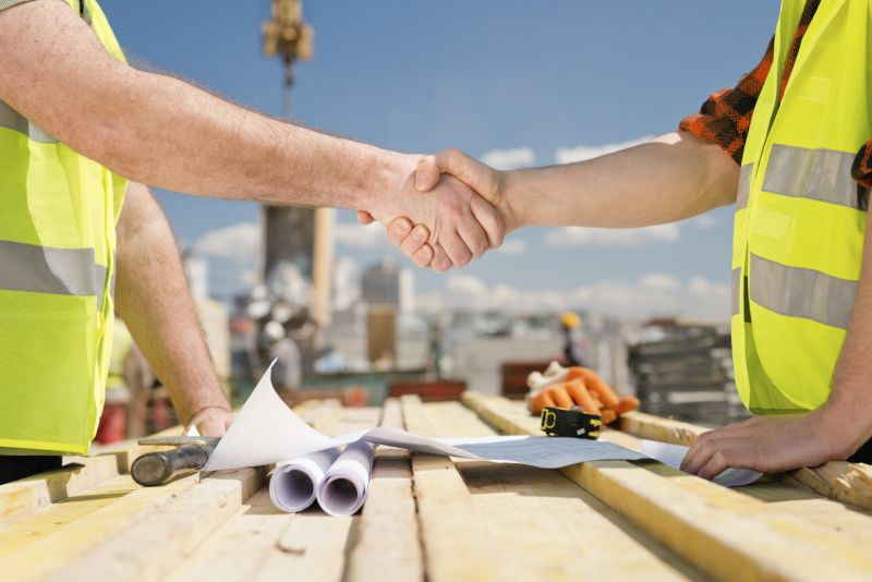 Construction Workers Shaking Hands On